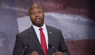 In this Nov. 5, 2015, photo, Sen. Tim Scott, R-S.C., speaks about the Guantanamo Bay Detention Facility during a news conference on Capitol Hill in Washington. The Senate is poised to pass a bill on Nov. 10, that bans moving Guantanamo Bay detainees to the United States, something Barack Obama has been trying to do since he was sworn in as president.  (AP Photo/Manuel Balce Ceneta)