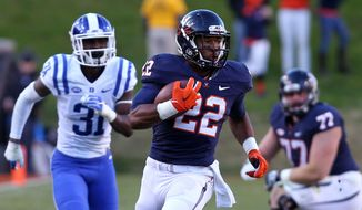 Virginia running back Daniel Hamm (22) runs in front of Duke cornerback Breon Borders (31) during an NCAA college football game Saturday, Nov. 21, 2015, in Charlottesville, Va. Virginia won 42-34. (Andrew Shurtleff/The Daily Progress via AP)