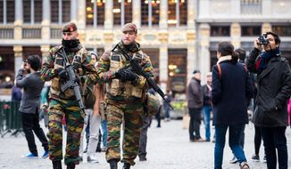 Belgian Army soldiers patrol in the picturesque Grand Place in the center of Brussels on Friday, Nov. 20, 2015. Salah Abdeslam, a French national who lived in Molenbeek, Belgium, is currently the subject of an international manhunt after the Paris attacks. Security has been stepped up in parts of Belgium as a precaution. (AP Photo/Geert Vanden Wijngaert) ** FILE **