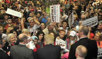 The crowd surges to greet Republican presidential candidate Donald Trump after he speaks during a campaign stop Saturday, Nov. 21, 2015 in Birmingham, Ala. (AP Photo/Eric Schultz)