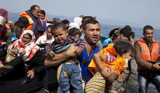 FILE - In this Sept. 10, 2015 file photo, Syrian refugees arrive aboard a dinghy after crossing from Turkey to the island of Lesbos, Greece. More than 76 years later, fresh angst about whether to admit refugees or turn them away has put the spotlight back on the 1939 shunning of the St. Louis, an ocean line carrying more than 900 Jewish refugees trying to escape Europe and other, now widely regretted, decisions by U.S. officials before and during World War II. (AP Photo/Petros Giannakouris, File)