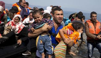 In this Sept. 10, 2015 file photo, Syrian refugees arrive aboard a dinghy after crossing from Turkey to the island of Lesbos, Greece. More than 76 years later, fresh angst about whether to admit refugees or turn them away has put the spotlight back on the 1939 shunning of the St. Louis, an ocean line carrying more than 900 Jewish refugees trying to escape Europe and other, now widely regretted, decisions by U.S. officials before and during World War II. (AP Photo/Petros Giannakouris, File)