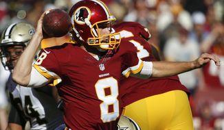 Washington Redskins quarterback Kirk Cousins (8) passes the ball during the first half of an NFL football game against the New Orleans Saints in Landover, Md., Sunday, Nov. 15, 2015. (AP Photo/Evan Vucci)