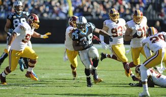Carolina Panthers' Jonathan Stewart (28) runs against the Washington Redskins in the first half of an NFL football game in Charlotte, N.C., Sunday, Nov. 22, 2015. (AP Photo/Mike McCarn)