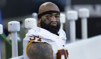 Washington Redskins' Jason Hatcher (97) sits on the bench late in the second half of an NFL football game against the Carolina Panthers in Charlotte, N.C., Sunday, Nov. 22, 2015. The Panthers won 44-16. (AP Photo/Bob Leverone)