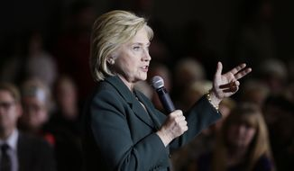 Democratic presidential candidate Hillary Rodham Clinton speaks during a town hall meeting Sunday, Nov. 22, 2015, in Clinton, Iowa. (AP Photo/Charlie Neibergall) ** FILE **