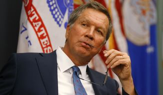 Republican presidential candidate, Ohio Gov. John Kasich listens during a tour of at the Macomb-Oakland University Incubator at the Velocity Center, Monday, Nov. 23, 2015 in Sterling Heights, Mich. (AP Photo/Paul Sancya)