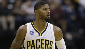 Indiana Pacers forward Paul George (13) in action during the second half of an NBA basketball game against the Boston Celtics, Wednesday, Nov. 4, 2015, in Indianapolis. The Pacers won the game 100-98. (AP Photo/Darron Cummings)
