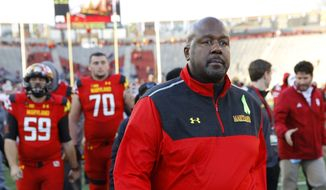 Maryland interim head coach Mike Locksley walks off the field after an NCAA college football game against Indiana, Saturday, Nov. 21, 2015, in College Park, Md. (AP Photo/Patrick Semansky)