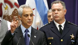 Chicago Mayor Rahm Emanuel, left, and Police Superintendent Garry McCarthy appear at a news conference on Nov. 24, 2015, in Chicago, announcing first-degree murder charges against police Officer Jason Van Dyke in the Oct. 20, 2014, death of 17-year-old Laquan McDonald. The city then released the dash-cam video of the shooting to media outlets after the news conference. (Associated Press) **FILE**