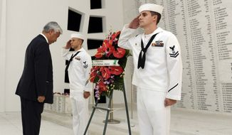 Japan Minister of Defense  Gen Nakatani, middle,  visits the USS Arizona Memorial, Monday, Nov. 23, 2015, to lay a wreath in the Shrine Room of the memorial. Nakatani was scheduled to meet with U.S. Pacific Command commander Adm. Harry Harris on Tuesday. The Pacific Command said Nakatani's discussions were expected to cover security in the region, including in the East and South China Seas. Ballistic missile defense was also on the agenda. (Bruce Asato/The Star-Advertiser via AP)