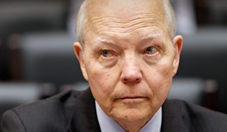 Internal Revenue Service Commissioner John Koskinen answers to the House Oversight Committee in the panel's continuing probe of whether tea party groups were improperly targeted for increased scrutiny by the government's tax agency, at the Capitol in Washington, Wednesday, March 26, 2014. Earlier this month, IRS official Lois Lerner was called to testify about the controversy but refused to answer questions by committee Chairman Darrell Issa, R-Calif., and invoked her Fifth Amendment rights at least nine times. (Associated Press Photo)