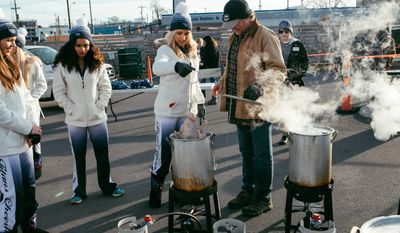 """Country music star Tracy Lawrence with members of the Tennessee Titans cheerleaders stages his 10th annual """"Missions: Possible"""" Turkey Fry, which took place Tuesday at Nashville's City Winery."""