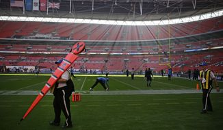 Detroit Lions players warm-up ahead of the NFL football game between Detroit Lions and Kansas City Chiefs Wembley Stadium in London, Sunday, Nov. 1, 2015. (AP Photo/Matt Dunham)