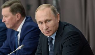 Russian President Vladimir Putin and chief of his staff Sergei Ivanov, left, take part in a meeting in Nizhny Tagil in the Ural mountains, Russia, on Wednesday, Nov. 25, 2015. Putin on Wednesday ordered long-range air defense missile systems to be deployed at a Russian air base in Syria following the downing of a Russian warplane by Turkey. (Alexei Nikolsky/Sputnik, Kremlin Pool Photo via AP)