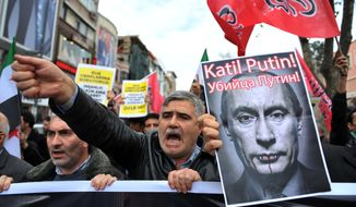 """Turkish protesters shout anti-Russia slogans as they hold a poster of Russian President Vladimir Putin that reads in Turkish and Russian """"Assassin Putin!"""" during a protest in Istanbul, Turkey, Friday, Nov. 27, 2015. Turkey shot down a Russian Su-24 bomber at the Syrian border on Tuesday, insisting it had violated its airspace despite repeated warnings. (AP Photo/Omer Kuscu) ** FILE **"""