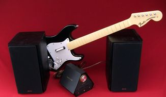A Fender Stratocaster guitar controller for Rock Band 4, the Sound Blaster X7 and EMU XM7 bookshelf speakers. (Photograph by Joseph Szadkowski / The Washington TImes)