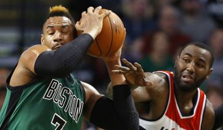 Boston Celtics' Jared Sullinger (7) grabs a rebound away from Washington Wizards' DeJuan Blair during the first quarter of an NBA basketball game in Boston, Friday, Nov. 27, 2015. (AP Photo/Winslow Townson)