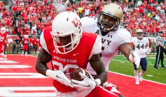 Houston's running back Tyreik Gray (26) makes a catch in the end zone for a touchdown during the first quarter of an NCAA college football game against Navy Friday, Nov. 27, 2015, in Houston. (AP Photo/Juan DeLeon)