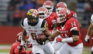 Maryland running back Ty Johnson (6) breaks tackles as he runs for yardage during the second half of an NCAA college football game against Rutgers Saturday, Nov. 28, 2015, in Piscataway, N.J. Maryland won 46-41. (AP Photo/Mel Evans)