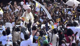 Pope Francis meets with young people at the Kololo airstrip in Kampala, Uganda, Saturday, Nov. 28, 2015. Pope Francis is in Africa for a six-day visit that is taking him to Kenya, Uganda and the Central African Republic.  (Giuseppe Cacace/ Pool Photo via AP)