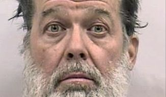 Police say Robert Lewis Dear, 57, killed three people and wounded nine others at the Planned Parenthood clinic on Nov. 27, before he finally surrendered after a 5-hour-long siege. He is facing first-degree murder charges.. (El Paso County Criminal Justice Center via Associated Press)