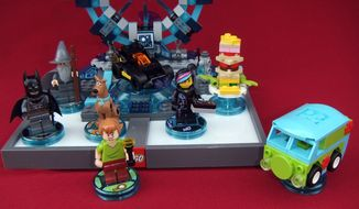 Batman, Gandalf, Scooby Doo, Shaggy and Wyldstyle work together in the video game Lego Dimensions. (Photograph by Joseph Szadkowski)