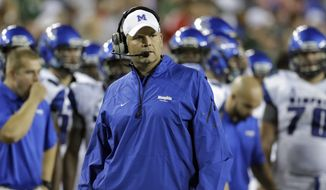 Memphis head coach Justin Fuente watches during the second quarter of an NCAA college football game against South Florida Saturday, Nov. 16, 2013, in Tampa, Fla. (AP Photo/Chris O'Meara)