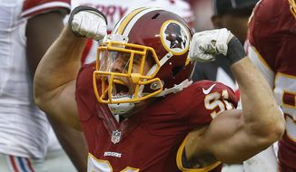 Washington Redskins outside linebacker Ryan Kerrigan (91) celebrates his sack of New York Giants quarterback Eli Manning (10) during the first half of an NFL football game in Landover, Md., Sunday, Nov. 29, 2015. (AP Photo/Patrick Semansky)