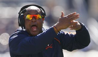Virginia head coach Mike London works his team during an NCAA college football game, Saturday, Oct. 10, 2015 in Pittsburgh. (AP Photo/Keith Srakocic)
