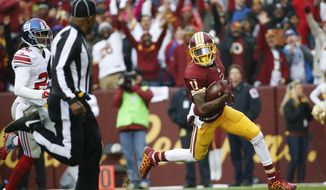 Washington Redskins wide receiver DeSean Jackson (11) carries the ball into the end zone for a touchdown after a pass reception from quarterback Kirk Cousins (8) during the first half of an NFL football game against the New York Giants in Landover, Md., Sunday, Nov. 29, 2015. (AP Photo/Alex Brandon)