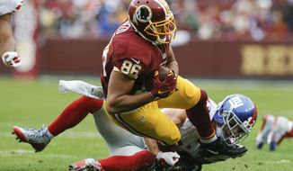 Washington Redskins tight end Jordan Reed (86) is stopped by New York Giants defensive back Craig Dahl (43) during the first half of an NFL football game in Landover, Md., Sunday, Nov. 29, 2015. (AP Photo/Patrick Semansky)