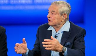 Two pro-democracy foundations launched by U.S. billionaire businessman George Soros have been officially banned by the Russian government. (Associated Press)
