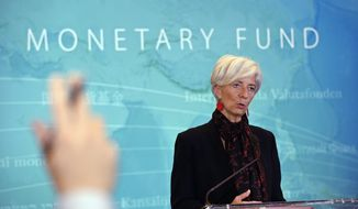 International Monetary Fund (IMF) Managing Director Christine Lagarde speaks during a news conference at the IMF in Washington, Monday, Nov. 30, 2015, to announce the Chinese yuan will join a basket of the world's leading currencies.  (AP Photo/Susan Walsh)
