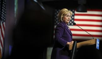 Democratic presidential candidate Hillary Clinton pauses while speaking at the at New Hampshire Democrats party's annual dinner in Manchester, N.H., Sunday, Nov. 29, 2015. (AP Photo/Cheryl Senter)
