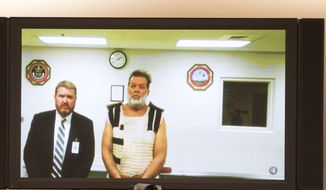 Colorado Springs Planned Parenthood shooting suspect Robert Dear, right, appears via video hearing during his first court appearance, where he was told he faces first degree murder charges, Monday, Nov. 30, 2015, in Colorado Springs, Colo. At left is public defender Dan King. (Mark Reis/The Gazette via AP, Pool)