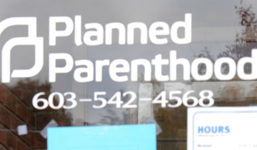 Planned Parenthood in Claremont, N.H., closes its doors on Oct. 21, 2015, as employees and professional cleaners responded to damage left by a vandal. (Associated Press) **FILE**