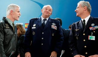 "NATO Supreme Allied Commander General Philip Breedlove (center) speaks with Czech Army General Petr Pavel (left) and French Air Force General Denis Mercier as the mutual-defense organization considers admitting Montenegro, a move Moscow says reverts to a Cold War policy of ""containing"" Russia. (Associated Press)"