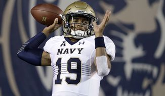 Navy quarterback Keenan Reynolds warms up before the start of an NCAA college football game against Memphis Saturday, Nov. 7, 2015, in Memphis, Tenn. (AP Photo/Mark Humphrey)