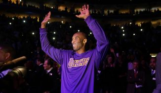 Los Angeles Lakers' Kobe Bryant acknowledges the audience ahead of a basketball game against the Philadelphia 76ers Tuesday, Dec. 1, 2015, in Philadelphia. (AP Photo/Matt Rourke)