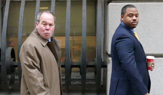 William Porter, right, one of six Baltimore city police officers charged in connection to the death of Freddie Gray, walks into a courthouse for jury selection in his trial, Monday, Nov. 30, 2015, in Baltimore. Porter faces charges of manslaughter, assault, reckless endangerment and misconduct in office. (Kevin Richardson/The Baltimore Sun via AP, Pool) ** FILE **
