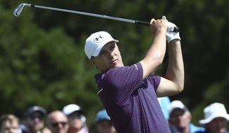 Jordan Spieth of the United States tees off on the 11th hole on the final day of the Australian Open golf tournament in Sydney, Australian, Sunday, Nov. 29, 2015. (AP Photo/Rob Griffith)
