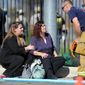 Two women speak with a firefighter at the triage area near the scene of a shooting in San Bernardino, Calif. on Wednesday, Dec. 2, 2015. Police responded to reports of an active shooter at a social services facility.   (Micah Escamilla/Los Angeles News Group via AP)