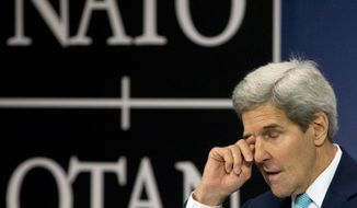 U.S. Secretary of State John Kerry pauses before speaking during a media conference at NATO headquarters in Brussels on Wednesday, Dec. 2, 2015. U.S. Secretary of State John Kerry says NATO members stand ready to step up military efforts against the Islamic State. (AP Photo/Virginia Mayo)