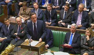 British Prime Minister David Cameron talks to lawmakers inside the House of Commons in London during a debate on launching airstrikes against Islamic State extremists inside Syria, Wednesday, Dec. 2, 2015.  The parliamentary vote is expected Wednesday evening. (Parliamentary Recording Unit via AP Video)