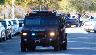 A swat team arrives at the scene of a shooting in San Bernardino, Calif., on Wednesday,  Dec. 2, 2015.  Police responded to reports of an active shooter at a social services facility. (Doug Saunders/Los Angeles News Group via AP) MANDATORY CREDIT