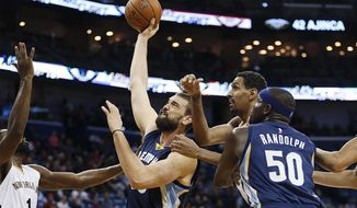 Memphis Grizzlies center Marc Gasol (33) goes to the basket against New Orleans Pelicans guard Tyreke Evans, left,  in the first half of an NBA basketball game in New Orleans, Tuesday, Dec. 1, 2015. (AP Photo/Gerald Herbert)