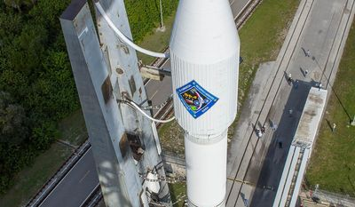 In this photo provided by the United Launch Alliance, an Atlas V rocket carrying the Orbital ATK Cygnus spacecraft, is rolled from the Vertical Integration Facility to a launch pad at the Cape Canaveral Air Force Station in Cape Canaveral, Fla., on Wednesday, Dec. 2, 2015. Orbital's Antares rocket is still grounded following a 2014 launch explosion that damaged a Virginia launch pad. (United Launch Alliance via AP)