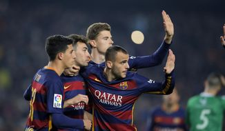 FC Barcelona's Munir El Haddadi, second left, reacts after scoring with his teammates against Villanovense during a Copa del Rey soccer match at the Camp Nou stadium in Barcelona, Spain, Wednesday, Dec. 2, 2015. (AP Photo/Manu Fernandez)