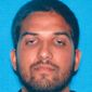 """This undated photo provided by the California Department of Motor Vehicles shows Syed Rizwan Farook who has been named as the suspect in the San Bernardino, Calif., shootings. Farook communicated with individuals who were under FBI scrutiny in connection with a terrorism investigation. But the official said the contact was with """"people who weren't significant players on our radar,"""" dated back some time, and there was no immediate indication of any """"surge"""" in communication ahead of the shooting. (California Department of Motor Vehicles via AP)"""